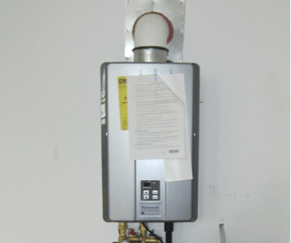 a compact design rv tankless water heater installed in RV