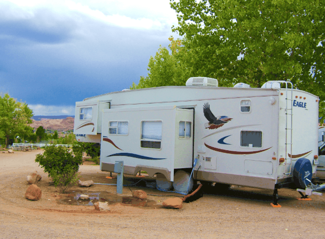 a fifth wheel rv connected to hookup