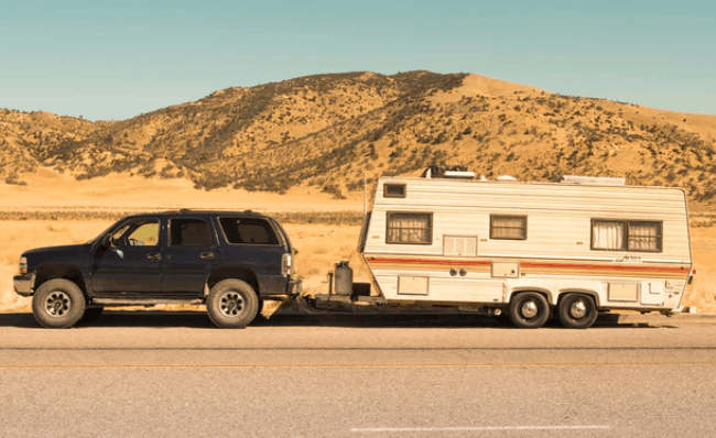 a old used travel trailer being towed