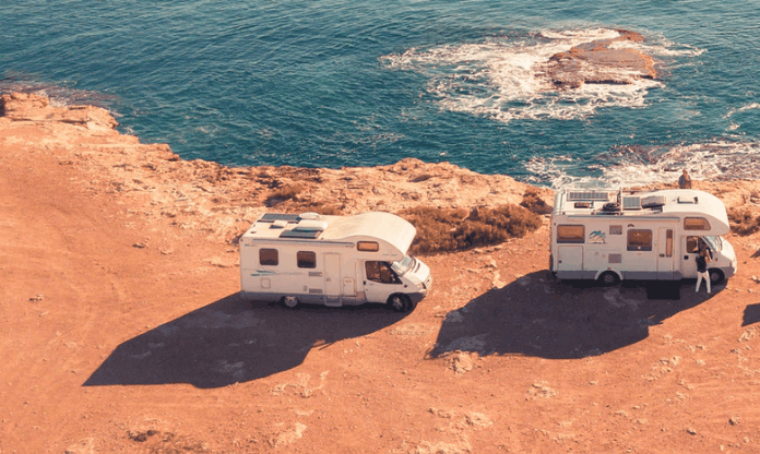roof visible on two rvs parked near sea