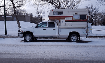 truck camper parked on the side of the road