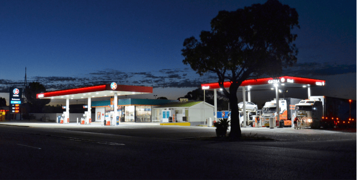trucks parked at night at a truck stop