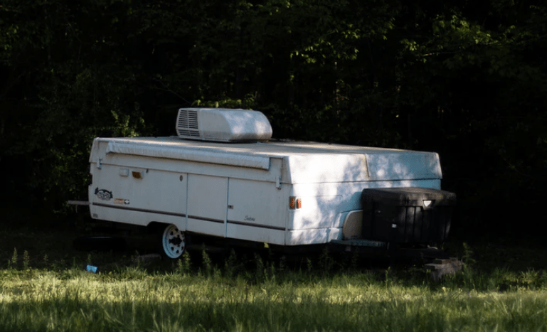 a pop up camper with air conditioner on it