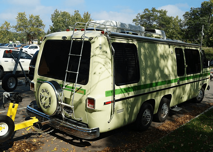 rv with roof rack and ladder